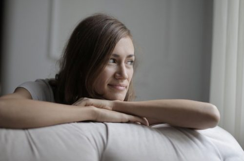woman lying on bed looking away